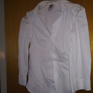 Button up shirt with lace on top of the sleeves.